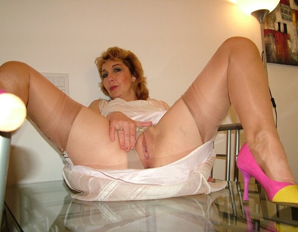 mature-erotic-crissy-stripping-on-the-table