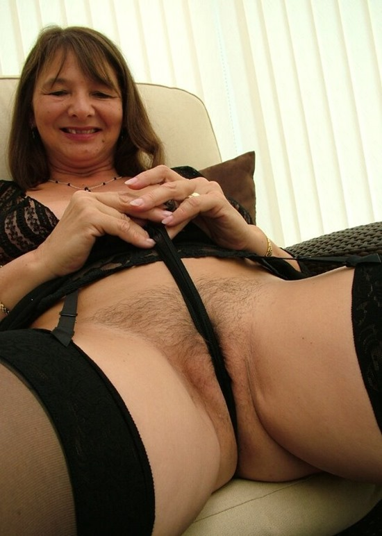 Mature Erotic Jill in a Black Mini